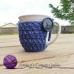 Textured Coffee Mug Cozy - Free Crochet Pattern by @ArtofaDG | Featured at Articles of a Domestic Goddess - Sponsor Spotlight Round Up via @beckastreasures | #fallintochristmas2016 #crochetcontest #spotlight #crochet #roundup