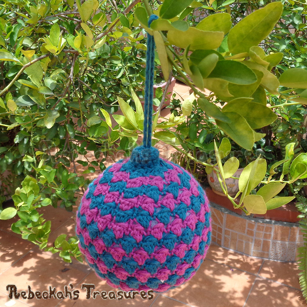 Striped Bobble Bauble on a lemon tree! | Amigurumi Crochet Pattern by @beckastreasures | Written pattern + photo tutorials too | Available to purchase in my #Ravelry & Website shops or via #GreybriarsTravels magazine - Get your copy today! | #crochet #pattern #amigurumi #christmas #bauble #ornament