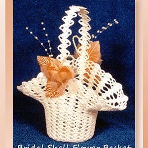 Bridal Shell Flower Basket - Crochet Pattern by @crochetmemories Featured at Crochet Memories - Sponsor Spotlight Round Up via @beckastreasures | #fallintochristmas2016 #crochetcontest #spotlight #crochet #roundup