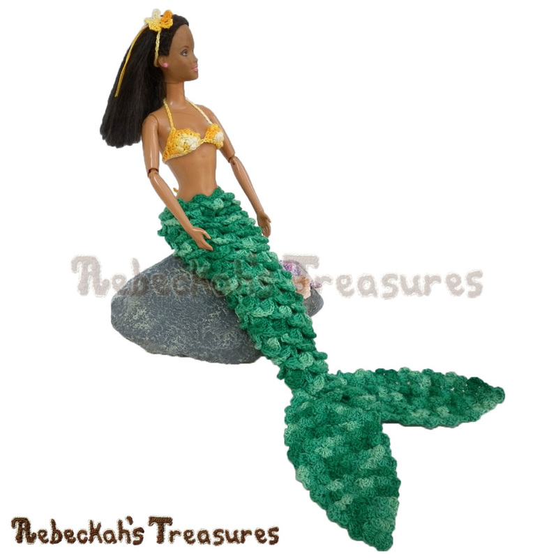 Fashion Doll Mermaid by @beckastreasures seated on a rock | Features a crocodile mermaid tail, the halter puff swirls brassiere, a sea flower headband & seashells!