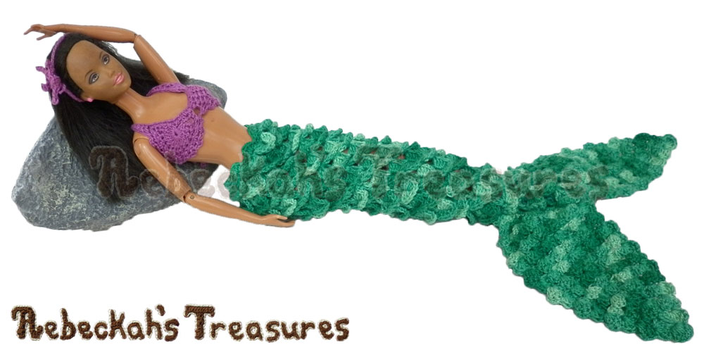 Fashion Doll Mermaid by @beckastreasures laying on a rock | Features a crocodile mermaid tail, the lacy loop swirls brassiere, a starfish headband & seashells!