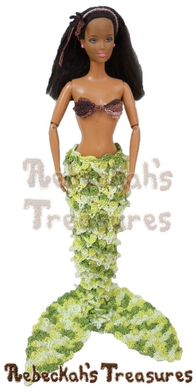 Fashion Doll Mermaid by @beckastreasures standing upright | Features a crocodile mermaid tail with beads, the sideways pearl shells brassiere & a starfish hair headband!