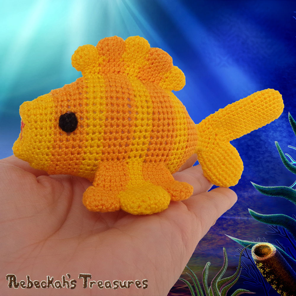 Goldfishy Amigurumi in the Palm of my Hand - LEFT View | Crochet Pattern by @beckastreasures | Will it be mirror decoration, part of a baby mobile or a cuddly toy? YOU get to decide!!! | | Available to purchase in my #Ravelry & Website shops, or as part of the April 2017 issue of @getstuffed - Get your copy today! | #crochet #pattern #goldfishy #fish #goldfish #amigurumi #GetStuffedMagazine