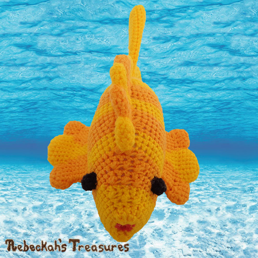 Goldfishy Amigurumi - Forehead View | Crochet Pattern by @beckastreasures | Will it be mirror decoration, part of a baby mobile or a cuddly toy? YOU get to decide!!! | | Available to purchase in my #Ravelry & Website shops, or as part of the April 2017 issue of @getstuffed - Get your copy today! | #crochet #pattern #goldfishy #fish #goldfish #amigurumi #GetStuffedMagazine