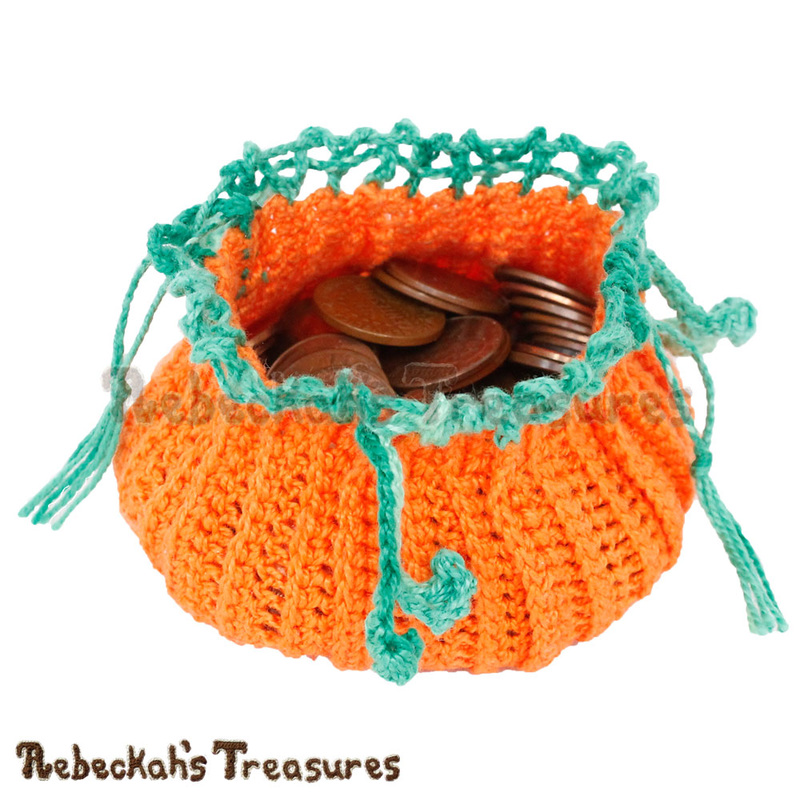Pumpkin Treats Coin Purse filled with pennies by @beckastreasures | Free Crochet Pattern via A Designer's Potpourri Year-Long CAL with @countrywillow12, @crochetmemories, @Sherrys2boyz & @ArtofaDG for October 2016 | #pumpkin #crochet #purse #autumn | Join today!